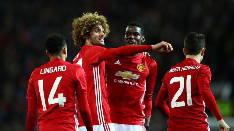 Fellaini celebrates with his team-mates after heading United's second goal
