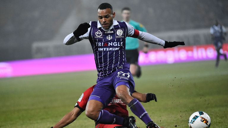 Toulouse's Danish forward Martin Braithwaite (R) is tackled by Dijon's French defender Yunis Abdelhamid during the French L1 football match between Dijon (