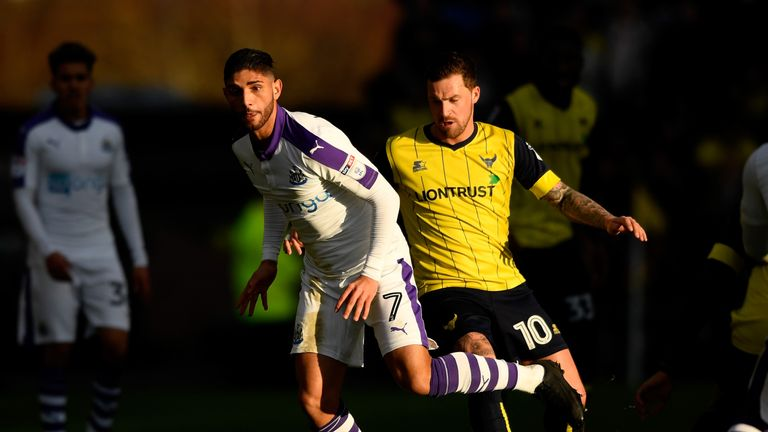 Achraf Lazaar and Chris Maguire compete for the ball