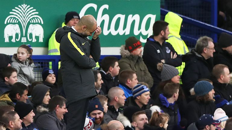 Pep Guardiola appears dejected on the touchline with his team 2-0 down