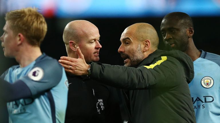 MANCHESTER, ENGLAND - JANUARY 02: Referee Lee Mason aruges with Josep Guardiola, Manager of Manchester City after the Premier League match between Manchest