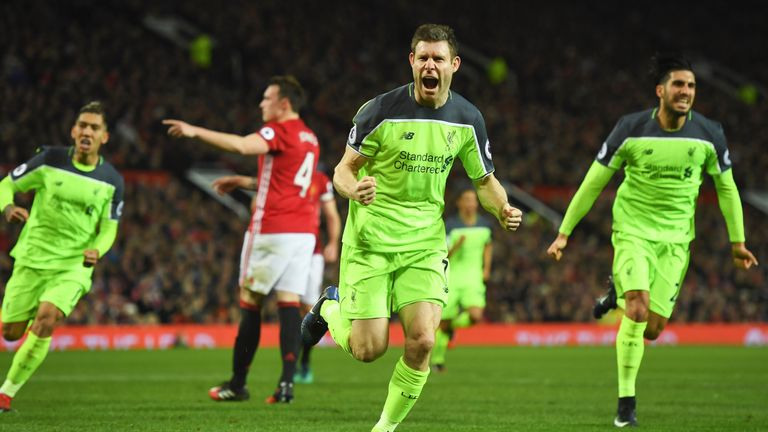 James Milner celebrates after giving Liverpool a 1-0 lead from the penalty spot