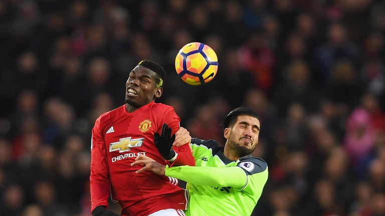 Paul Pogba and Emre Can compete for the ball