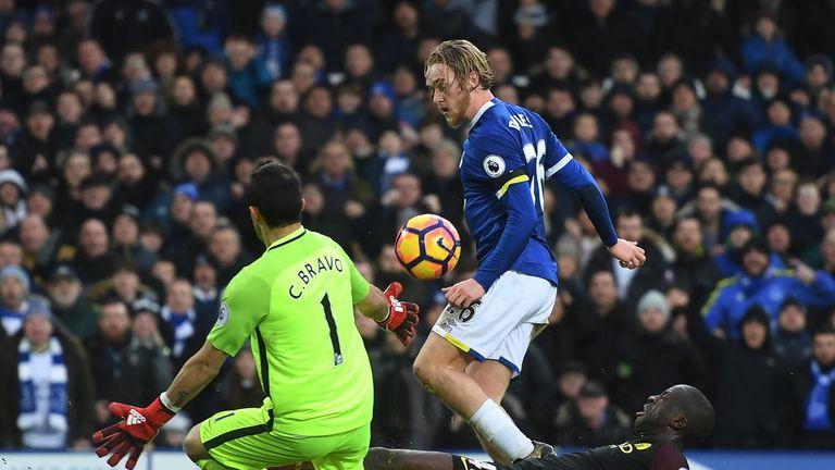 Tom Davies lifts the ball over Claudio Bravo to score Everton's third