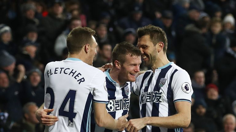 Chris Brunt celebrates with team-mates after levelling the score at The Hawthorns