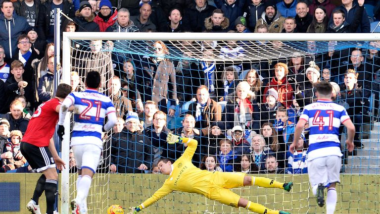Alex Smithies of Queens Park Rangers (C) saves Chris Martin's penalty during the Sky Bet Championship match