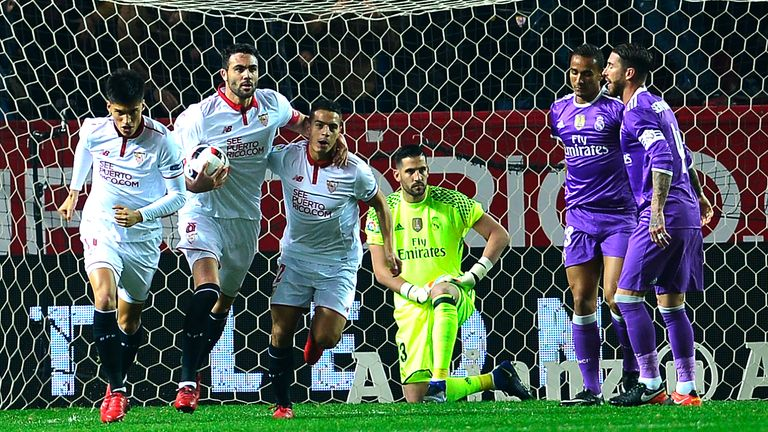 Sevilla players celebrate after Danilo scored an own goal
