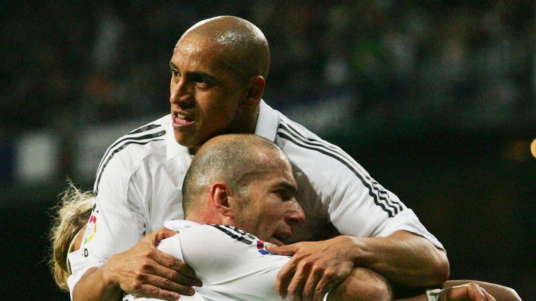 Roberto Carlos and Zinedine Zidane celebrate together at Real Madrid