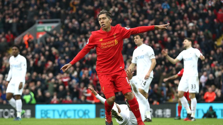 LIVERPOOL, ENGLAND - JANUARY 21: Roberto Firmino of Liverpool celebrates scoring his sides first goal during the Premier League match between Liverpool and