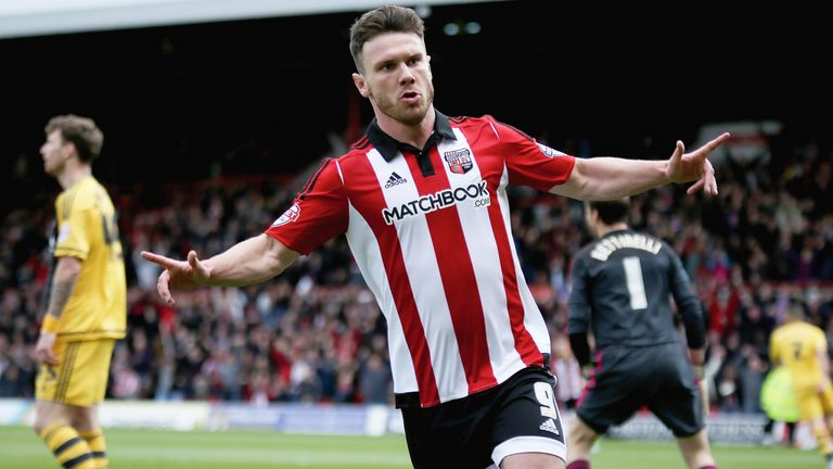Scott Hogan celebrates during the Sky Bet Championship match against Fulham at Griffin Park