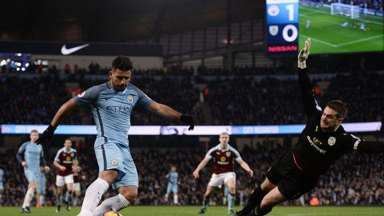 Sergio Aguero (L) scores past Burnley's Tom Heaton