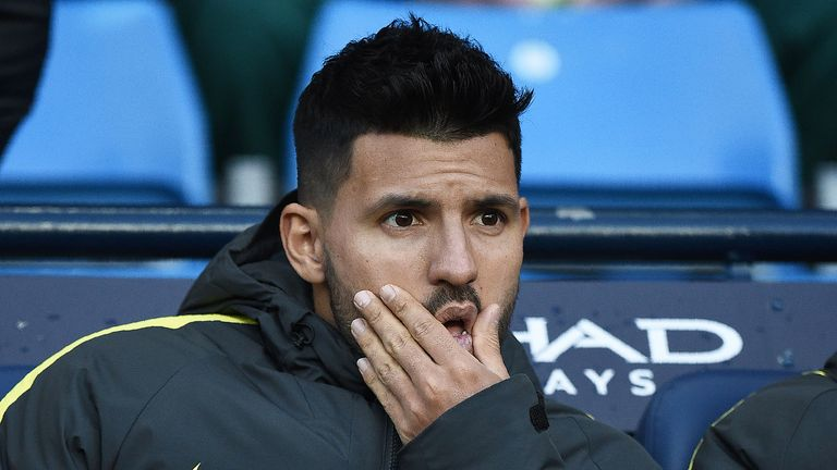Sergio Aguero watches the action from the Manchester City bench