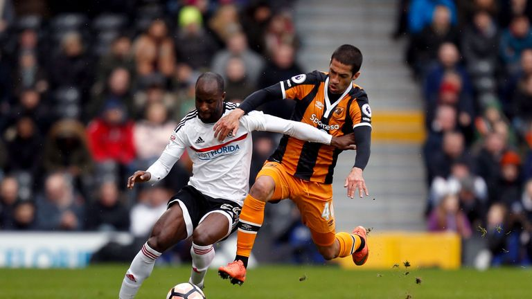 Sone Aluko tries to get away from Evandro