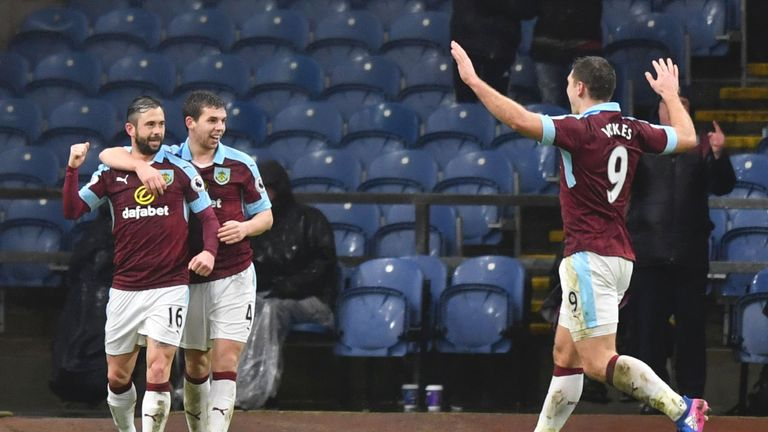 Burnley's Belgian midfielder Steven Defour (L) celebrates scoring their second goal during the English FA Cup fourth round football match between Burnley a