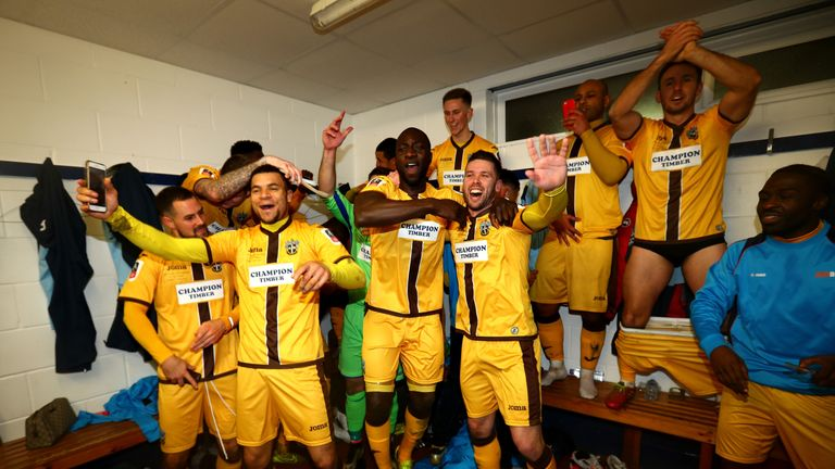 Sutton United players celebrate after knocking AFC Wimbledon out of the FA Cup
