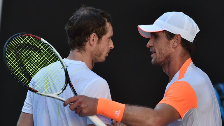 Zverev (right) consoles Murray after his shock 7-5 5-7 6-2 6-4 win