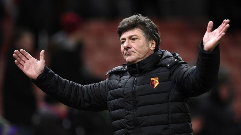 Watford's Italian manager Walter Mazzarri gestures as he leaves the pitch
