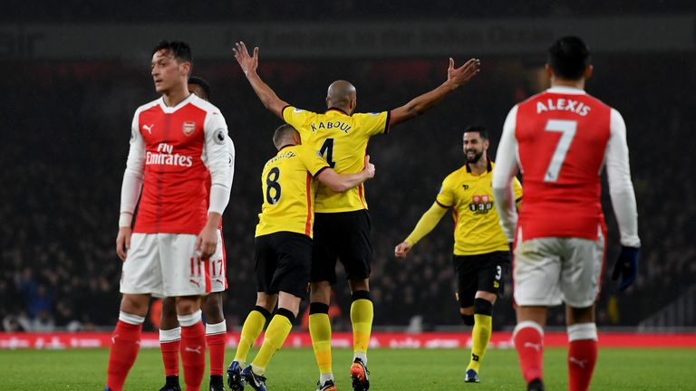 LONDON, ENGLAND - JANUARY 31:  Younes Kaboul (C) of Watford celebrates scoring the opening goal with his team mate Tom Cleverley (2nd L) during the Premier
