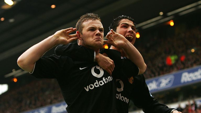 LIVERPOOL, ENGLAND - JANUARY 15:  Wayne Rooney and team mate Cristiano Ronaldo of Manchester United respond to Liverpool fans after Rooney scored during th