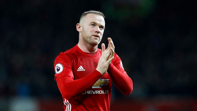 Wayne Rooney applauds fans after the match against Liverpool