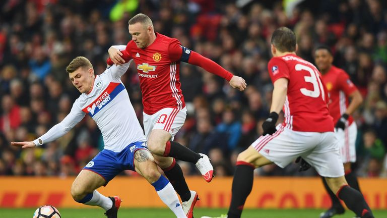 Wayne Rooney tangles with Max Power