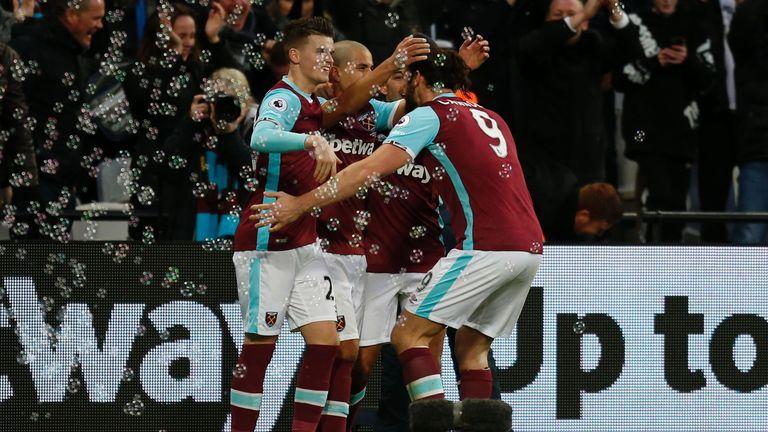 West Ham United's French-born Algerian midfielder Sofiane Feghouli (2nd L) celebrates with team-mates