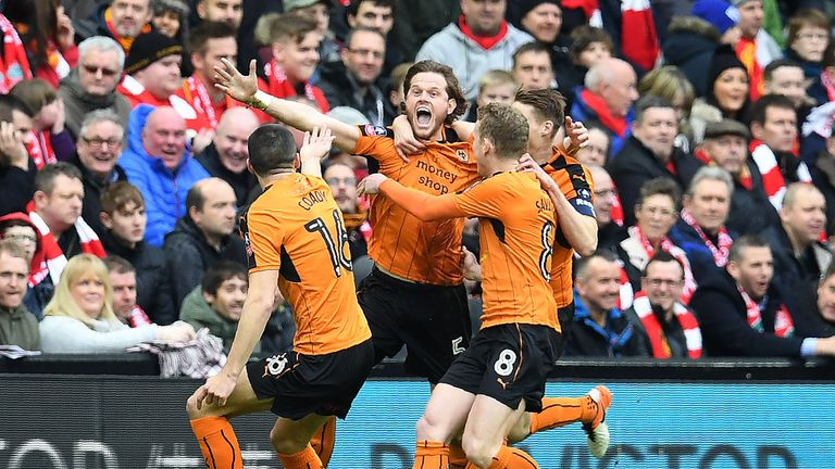 Richard Stearman (C) celebrates with team-mates after scoring for Wolves against Liverpool in the FA Cup fourth round