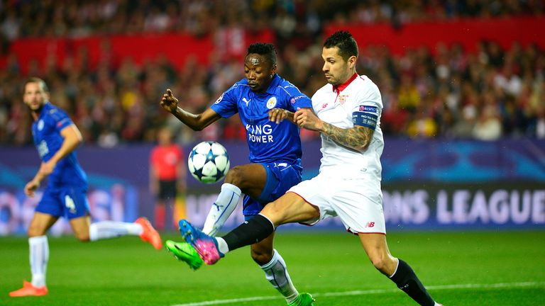 Ahmed Musa (L) vies with Vitolo, Sevilla v Leicester, Champions League