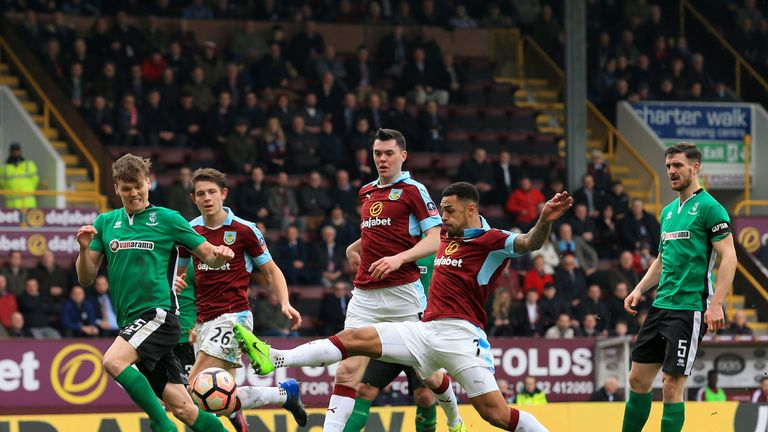 Andre Gray of Burnley (R) shoots during The Emirates FA Cup Fifth Round match between Burnley and Lincoln City at Turf Moor