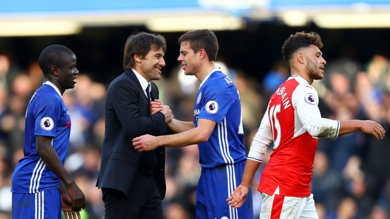 Antonio Conte, manager of Chelsea shakes hands with Cesar Azpilicueta after the Premier League match v Arsenal
