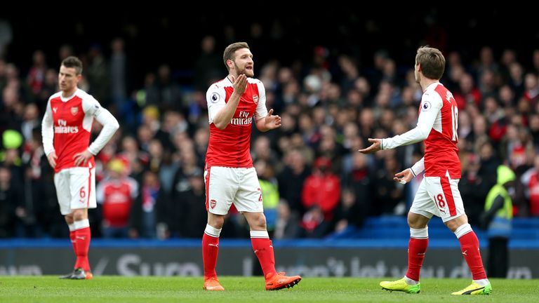 Arsenal's Laurent Koscielny (left), Arsenal's Shkodran Mustafi (centre) and Arsenal's Nacho Monreal (right) appear dejected after Chelsea's Marcos Alonso (