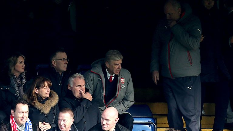 Arsene Wenger sits in the stands at Stamford Bridge while serving his touchline ban