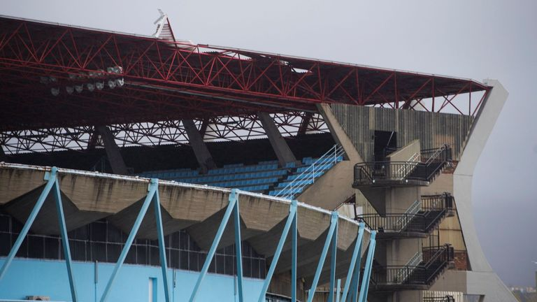 A picture taken on February 4, 2017 shows the dammaged roof of the Rio Alto grandstand in the Balaidos stadium in Vigo caused by heavy wind. Dammages that