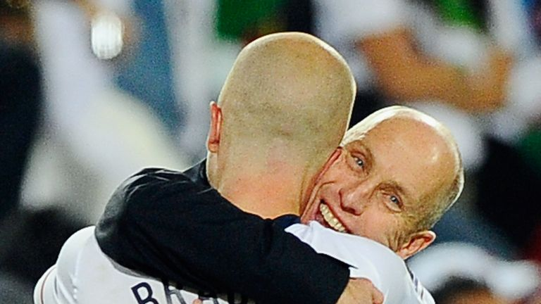 Bob Bradley hugs his son Michael Bradley after USA defeated Algeria in the 2010 FIFA World Cup