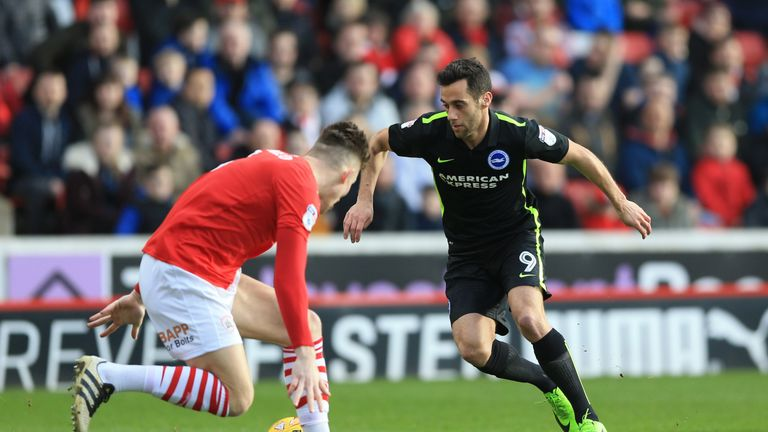 Barnsley's Angus MacDonald (left) and Brighton & Hove Albion's Sam Baldock battle for the ball during the Sky Bet Championship match at Oakwell, Barnsley