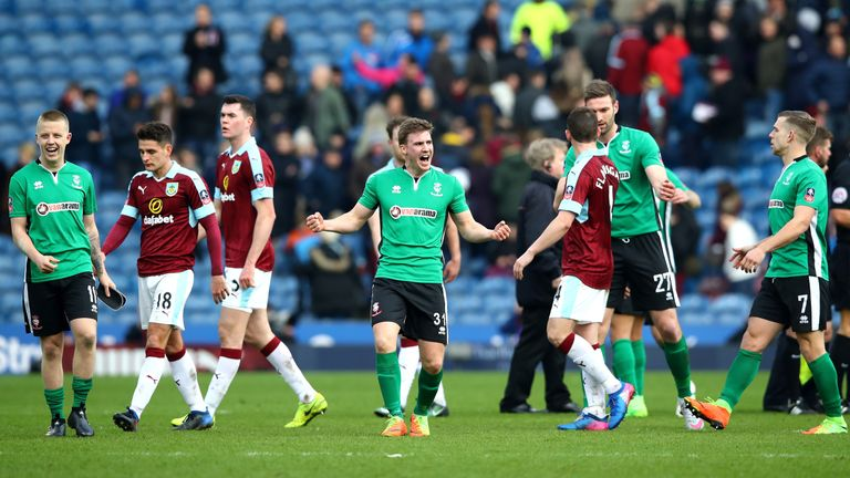 Burnley's players show their despair after losing to non-league Lincoln in the cup