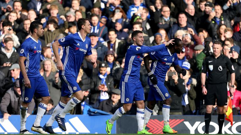 Eden Hazard celebrates with team-mates after putting Chelsea 2-0 up