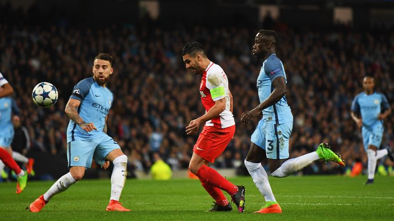 MANCHESTER, ENGLAND - FEBRUARY 21:  Radamel Falcao Garcia of AS Monaco (C) scores their third goal during the UEFA Champions League Round of 16 first leg m