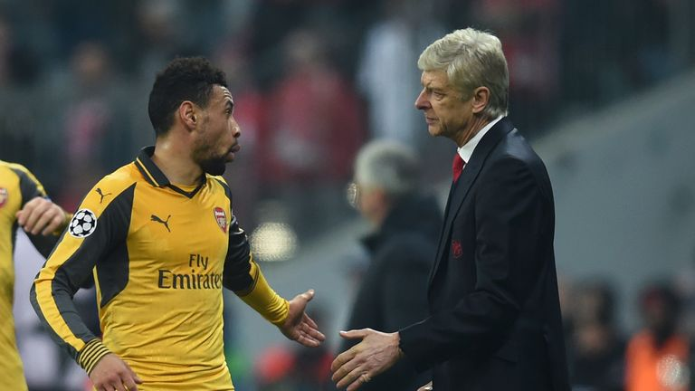 Arsenal's French midfielder Francis Coquelin (L) and Arsenal's French headcoach Arsene Wenger (R) speak together during the UEFA Champions League round of