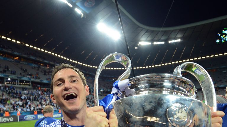 Lampard celebrates with the Champions League trophy after defeating Bayern in Munich in 2012