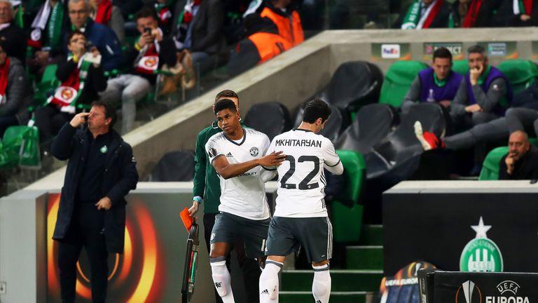Henrikh Mkhitaryan leaves the pitch injured to be replaced by Marcus Rashford