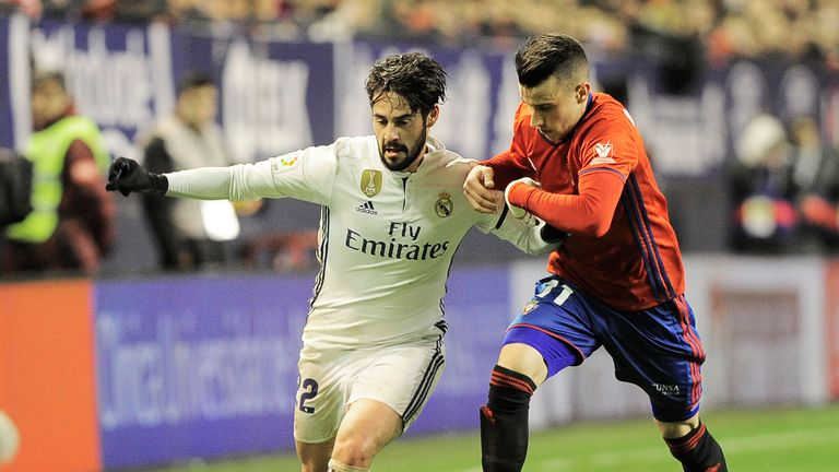 Real Madrid midfielder Isco (left) vies with Osasuna's midfielder Alex Berenguer