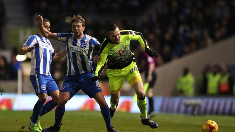Reading's Jordon Mutch (right) is tackled by Brighton and Hove Albion's Dale Stephens