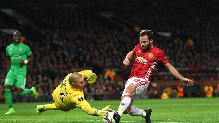 Stephane Ruffier of Saint-Etienne attempts to stop Juan Mata of Manchester United during the UEFA Europa  League