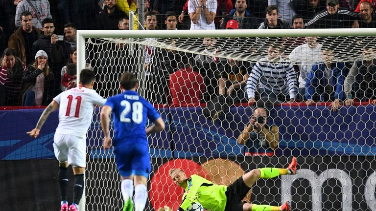 SEVILLE, ENGLAND - FEBRUARY 22:  Kasper Schmeichel of Leicester City saves a penalty from Joaquin Correa of Sevilla during the UEFA Champions League Round