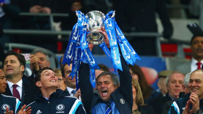 Manager Jose Mourinho of Chelsea lifts the trophy during the Capital One Cup Final match between Chelsea and Tottenham Hotspur