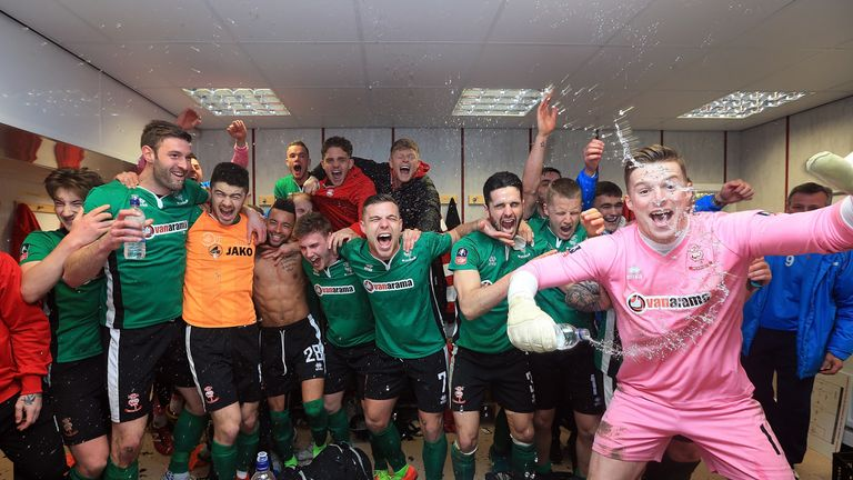 BURNLEY, ENGLAND - FEBRUARY 18:   The Lincoln City team celebrate their win in the changing room after The Emirates FA Cup Fifth Round match between Burnle