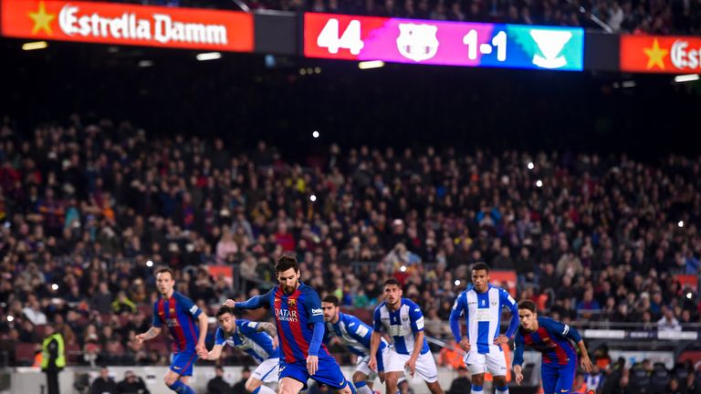 Barcelona forward Lionel Messi scores his side's winner from the spot late on against Leganes on Sunday