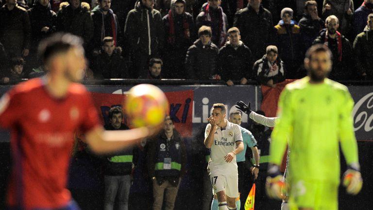 Lucas Vazquez (centre) celebrates after scoring Real's third goal