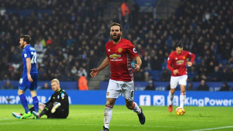 LEICESTER, ENGLAND - FEBRUARY 05:  Juan Mata of Manchester United celebrates as he scores their third goal during the Premier League match between Leiceste